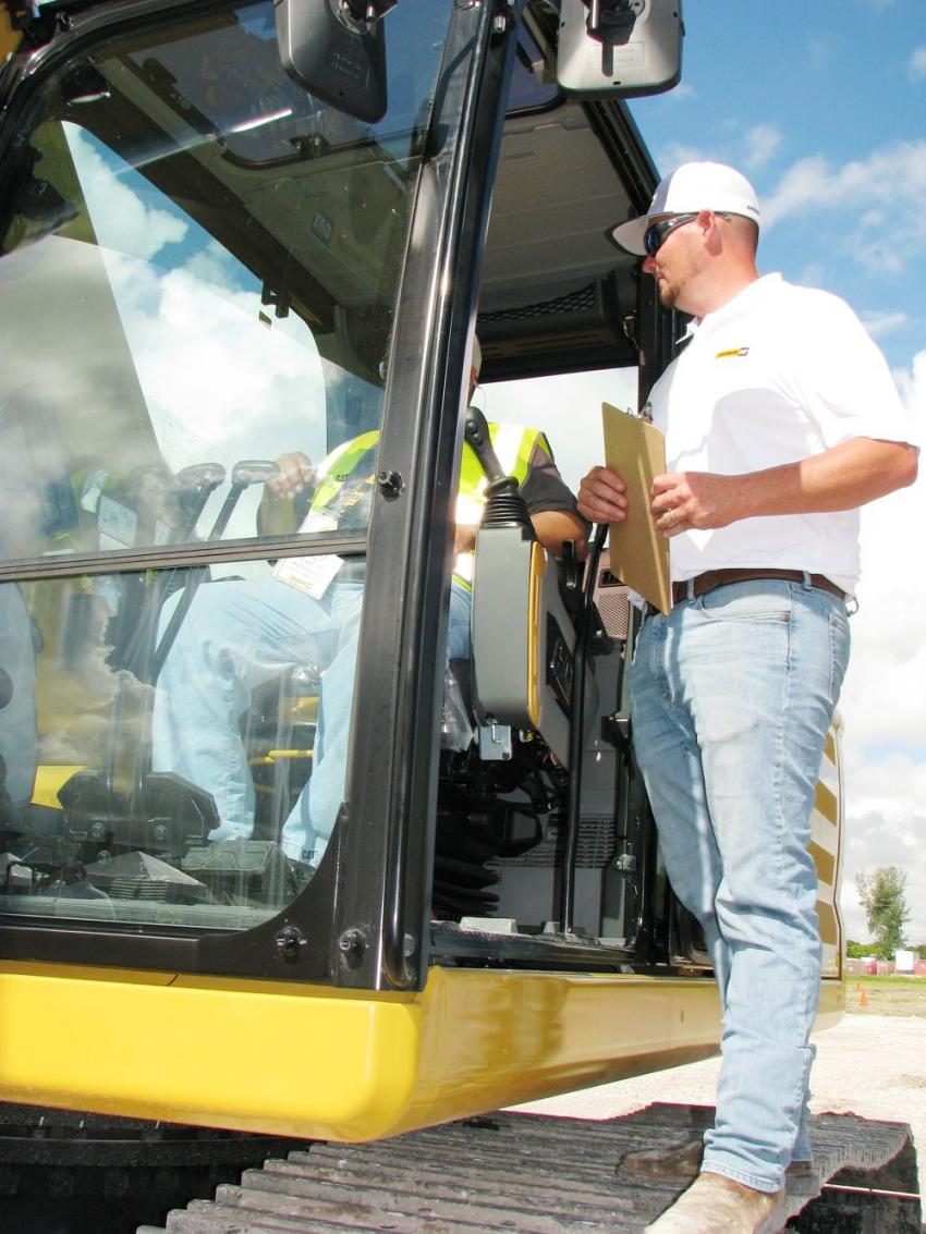 Robby Dale of Kelly Tractor gives complete instructions to a contestant for the Cat 336 excavator competition.