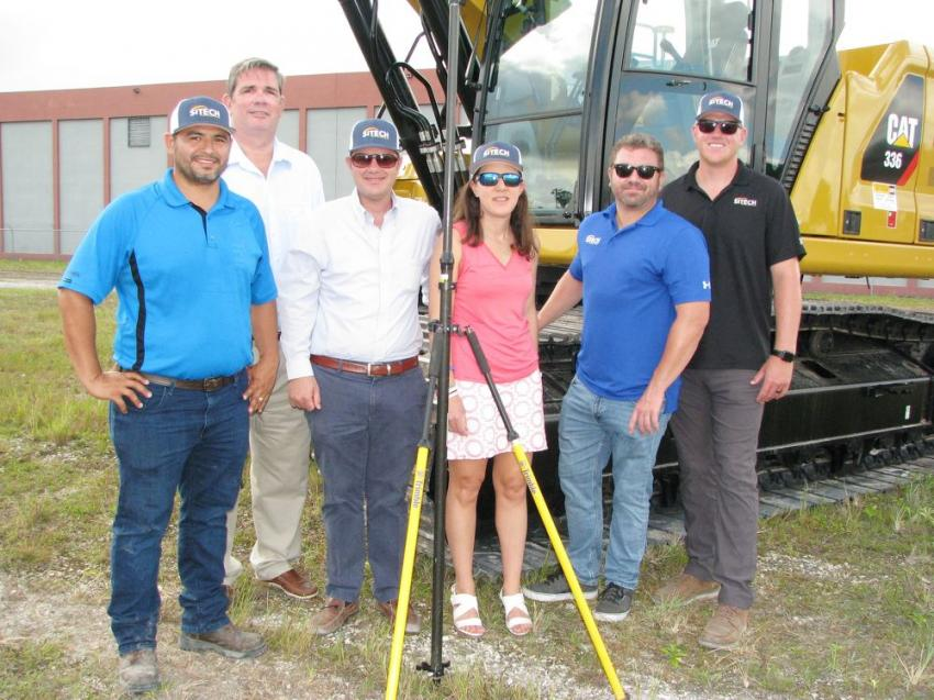 SITECH South staffers join the Kelly family at the event and (L-R) include Orlin Gavarrete and Robert Hutchinson, SITECH South; Chris Kelly and Katherine Kelly of Kelly Tractor; Spencer Dean and Stephen Miraglia of SITECH South.