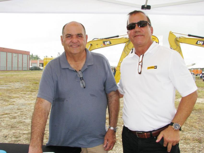 Antonio Perez (L) of McEvoy Construction, Miami, Fla., gets a warm welcome to the event from his Kelly Tractor sales representative Tony Allanic.