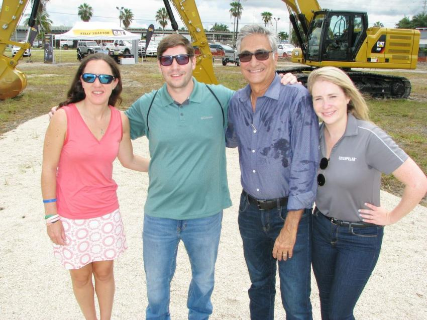 Enjoying their day in the sun (and some rain) on Friday of the competition (L-R) are Katherine Kelly; Louis Mijares, Bulk Express Transport, Miami, Fla.; Ramiro Cabana, who has had a remarkable 41-year sales career at Kelly Tractor; and Caroline Fisher of Caterpillar.