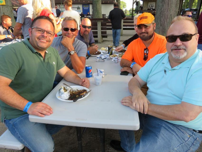 (L-R): Enjoying the steaks are Mike Drousias of Austin Tyler Construction Inc. and Chris Wirkus, Edward Knapp and Dan Darden all of Gallagher Asphalt Corporation.