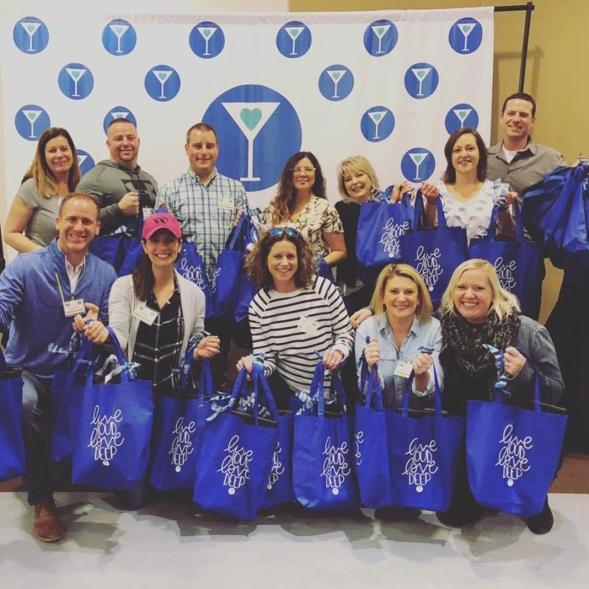 West Side employees joined forces with Cocktails & Chemo to distribute 100 care packages to local cancer caregivers in the Chicago area.