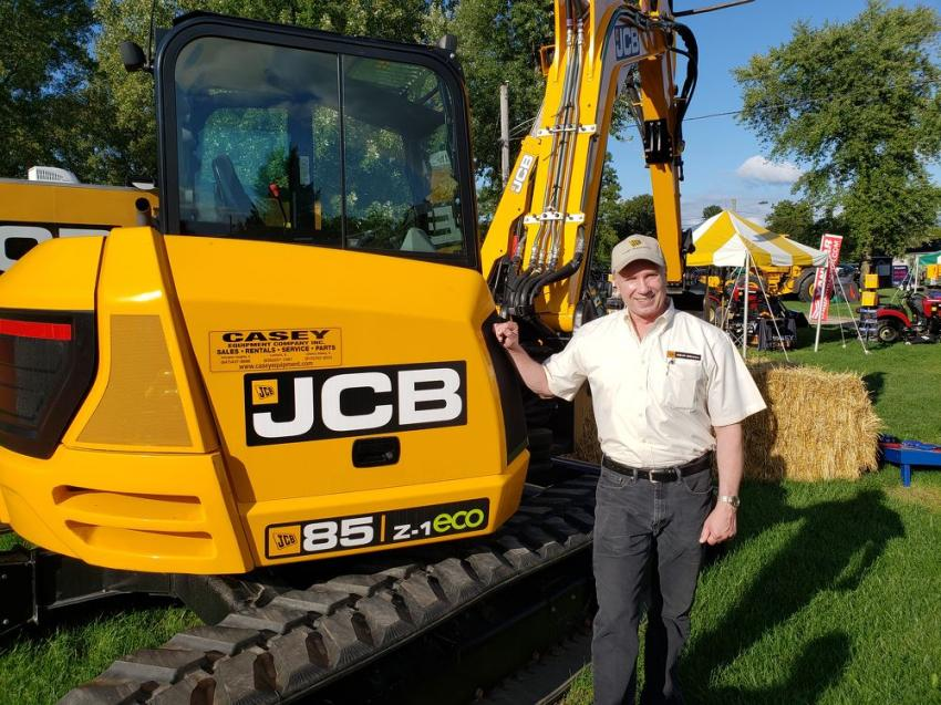 Mike Fay, territory manager of Casey Equipment, shows off the JCB 85Z-1 mini-excavator.