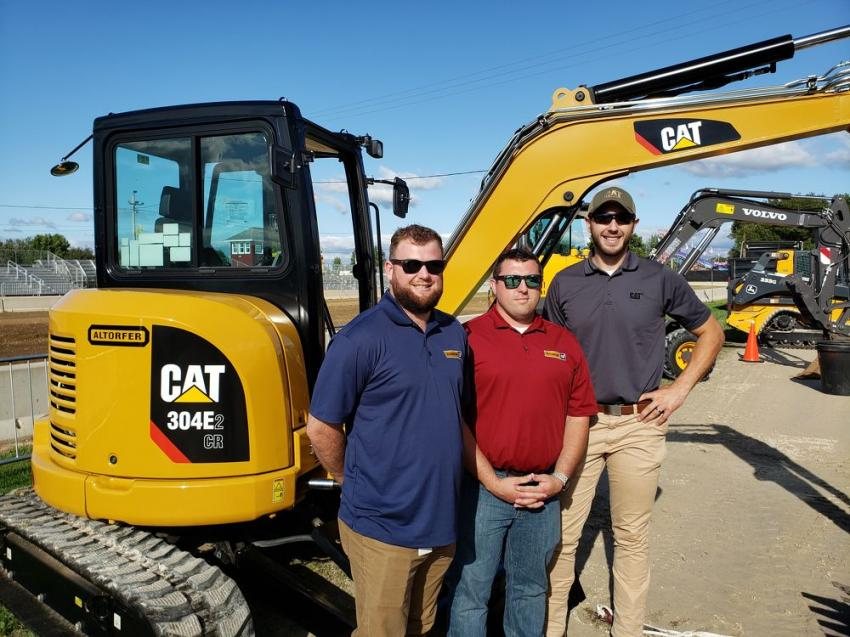 (L-R): Altorfer Cat's Sam Will, Josh Carter and Drew Stahl are ready for fairgoers to view this Cat 304E mini-excavator.