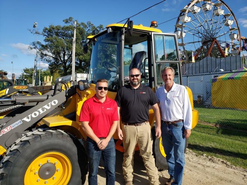 Representing Alta Equipment Co. are (L-R) Adam Strickland, Josh Reck, Tim Stratinsky and this Volvo L30G compact wheel loader.
