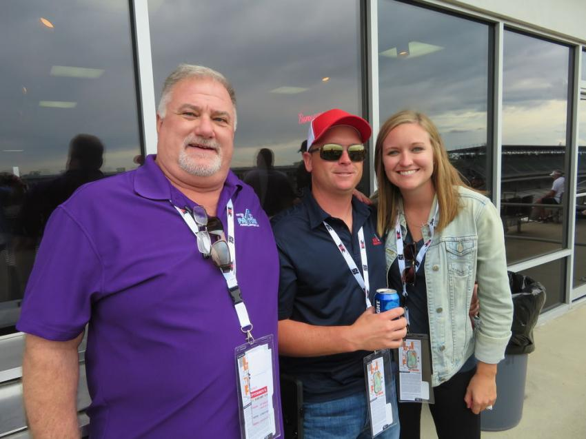 (L-R): Vince Voetberg, Michigan sales manager of Walter Payton Power Equipment LLC, and Joe and Jessica Kraniak of M&W crane rental, settle in to watch the race.