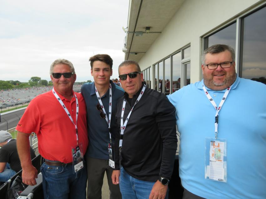(L-R): Harold Rogers of Northern Pipeline Co.; Patrick Bracken and his dad, James, of Brackenbox Roll Off Services Inc.; and Mark Dehnert, area manager of Howell Tractor & Equipment, catch up before the race begins.