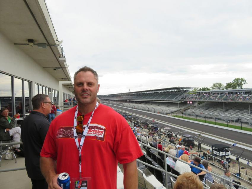 Josh Frasher of Goettle Construction enjoys the view of the Brickyard 400 from the Mi-Jack Tower Terrace suite.