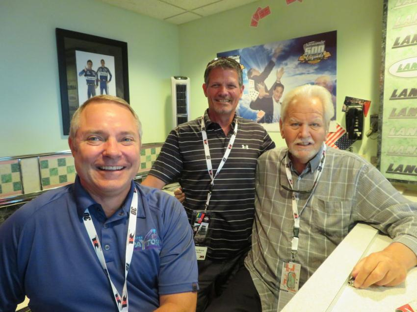 (L-R): Phillip Wichowsky of Walter Payton Power Equipment LLC, Perry Bruce of R H Marlin Inc. and Mike Lanigan, chairman of the board of Lanco Group of Companies and president of Mi-Jack, catch up while waiting for the race to begin.