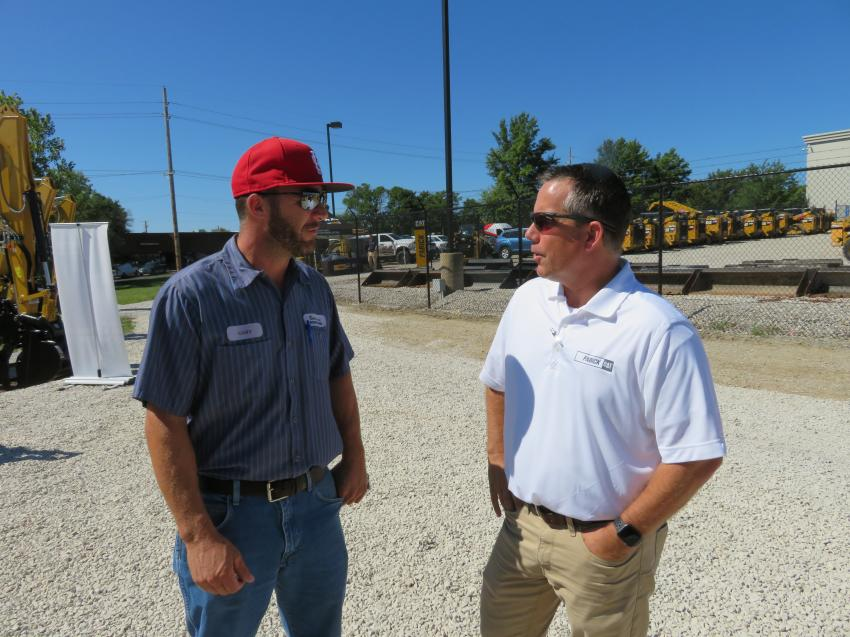 Gary Wersal (L) of Gershenson Construction Inc. and Tom Schuman of Fabick Cat discuss the new machines.