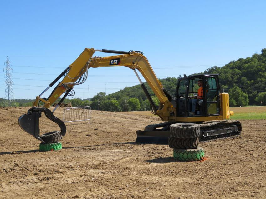 A customer competes in the tire stacking competition with the Cat 309 mini-excavator.
