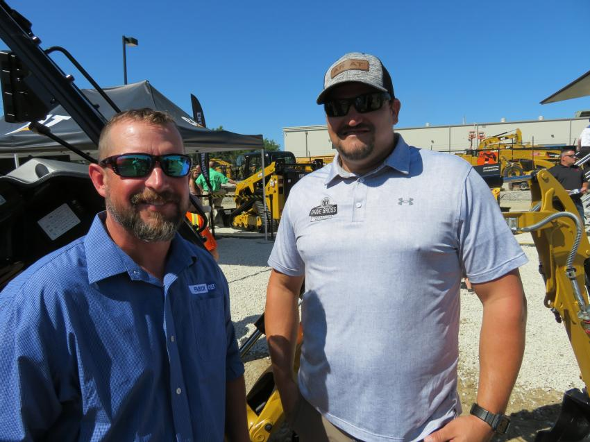 Josh Malone (L) of Fabick Cat goes over all of the new upgrades to the Cat 301.7CR mini-excavator with Dave Bross of Bross Contracting Services.