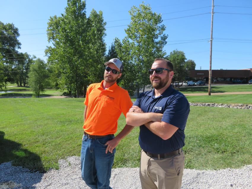 Luke Struckhoff (L) of Lamke Trenching & Excavating Inc. discusses the next generation of mini-excavators with Fabick Cat's Chris Wunderlich.