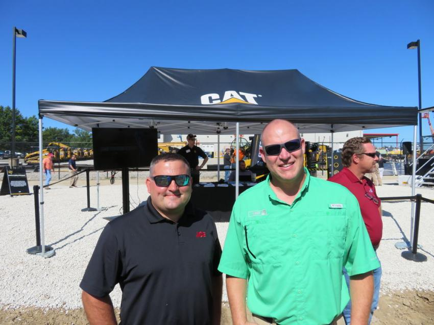 Jarrett Hillebrand (L) of ACE Hardware and Stewart England of Fabick Cat are on hand to preview Caterpillar's next generation of excavators.