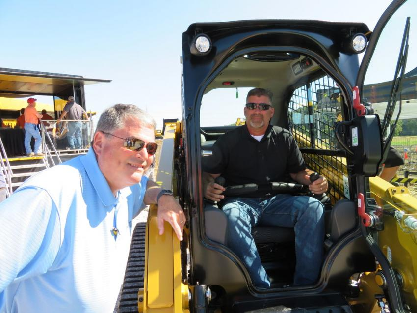 Terry Hennessey (L) of Fabick Cat answers some questions about the Cat 249D track skid steer from Doug Thurman of Castle Contracting LLC.