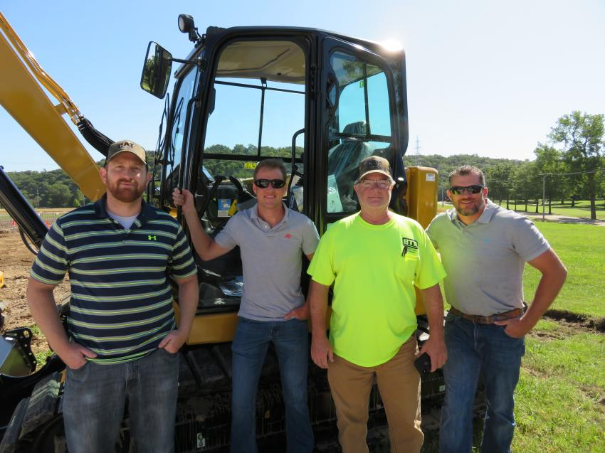 (L-R): Having a look at the Cat 309CR mini-excavator are Tom Schuh, Nathan Walck, Bryan Helbig and Tripp Spreckelmeyer, all of Ballast Tools Equipment.