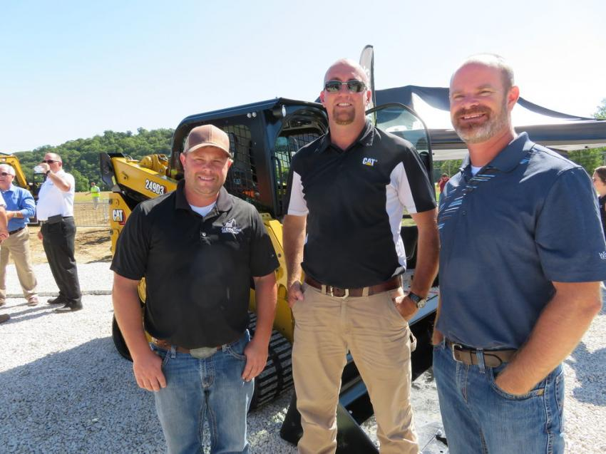 Craig Harris (C) of Fabick Cat talks with Justin Colbert (L) and Dean McDonald, of Geeding Construction Inc.