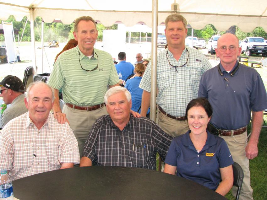 Some of the spectators watching the competition included (L-R, seated): Mike Thompson of Thompson Tractor; Sam Newell of W.S. Newell, Montgomery, Ala.; Lucy Thompson Marsh of Thompson Tractor; (L-R, standing): Skip Plumlee, Todd Cowan and Earnie Lewis of Thompson Tractor.