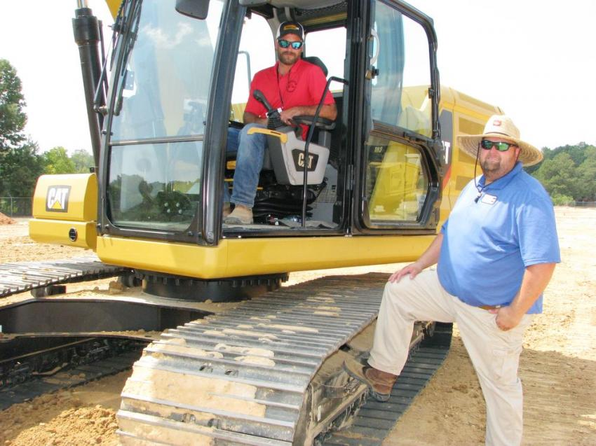 Lee Curtis (in cab) of Kelley's Welding & Excavation, Elberta, Ala., talks with Clayton Walley, Thompson Tractor certified dealer instructor, as he awaits his official run at the Cat excavator challenge.