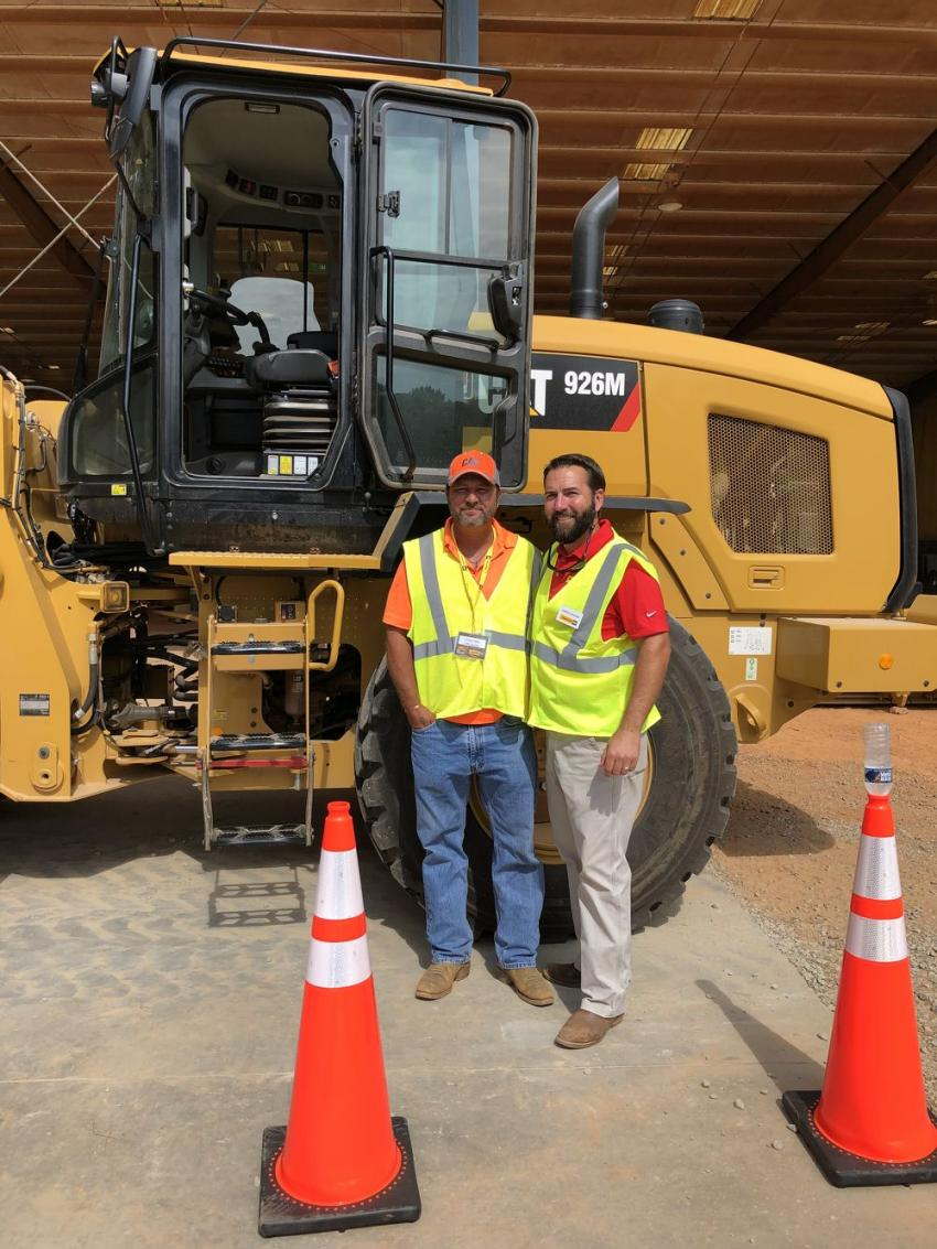 Travis Felts (L) of FMC Grading in Durham, N.C., gets an overview of the Cat 926M wheel loader and the obstacle course challenge from Jared Bauer of Gregory Poole Equipment Company.