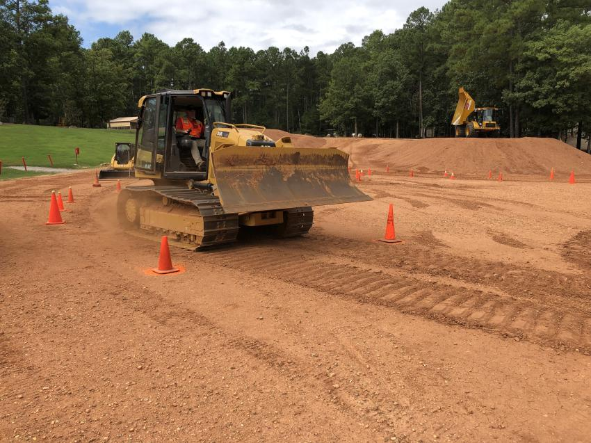 An operator from Wilmington, N.C., maneuvering the Cat D5K LGP machine through the obstacle course.