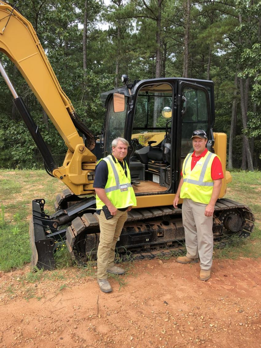 Looking over the Cat 308 CR excavator are Greg Everson (L) of East Coast Contracting in Wilmington, N.C., and Garrett Poplin of Gregory Poole Equipment Company.