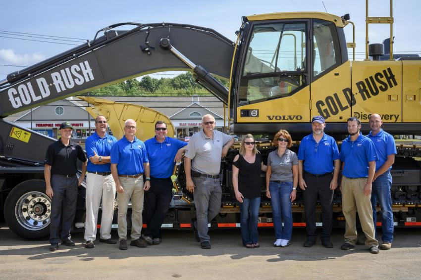 Part of the Tyler Equipment's team in front of Volvo's special edition Gold Rush excavator (L-R) are Joel Fuffish, Matt Tyler, Doug Ryan, Jasper Diers, Bruce Tuper, Jackie Nageotte, Shirley Worlund, Roland Mason, Sean King and Peter Gaj.