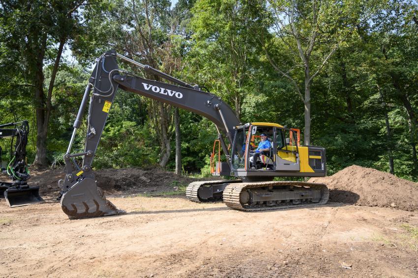 Roland Mason, account coordinator of excavators of Tyler Equipment, demonstrates the new Volvo EC200L excavator.