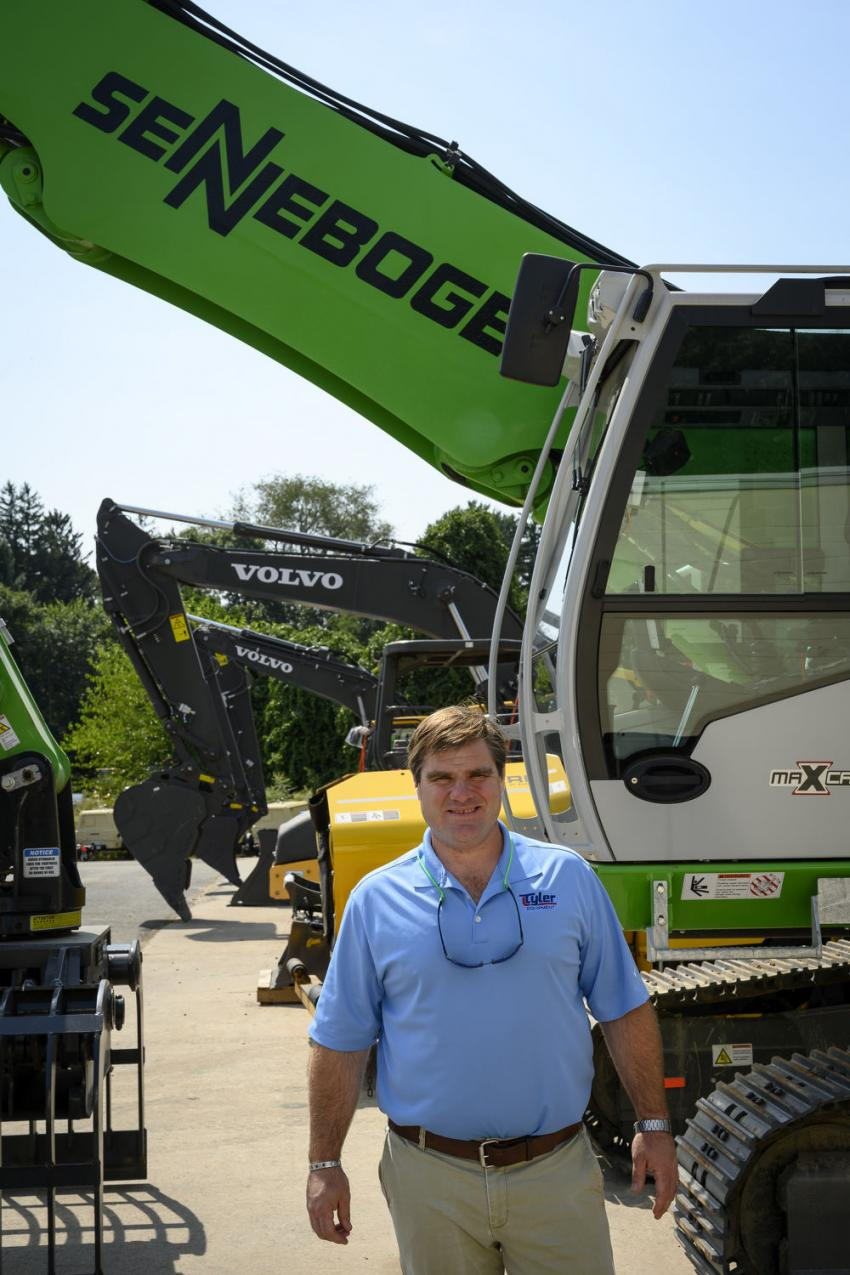 Bill O'Keefe, sales representative of Tyler Equipment, stands in front of a Sennebogen 818 crawler.