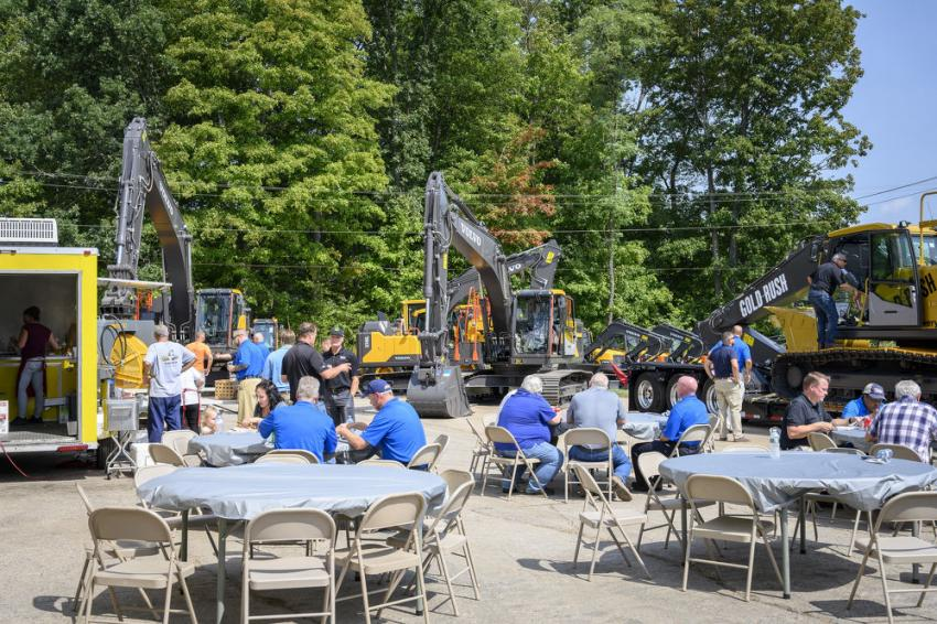 Guests enjoy lunch while others check out the Gold Rush excavator on display.