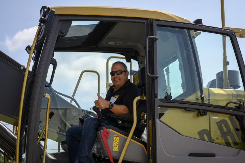 Kenny Burns of Kenny Burns Construction, Stratford, Conn., inside of the Gold Rush excavator.