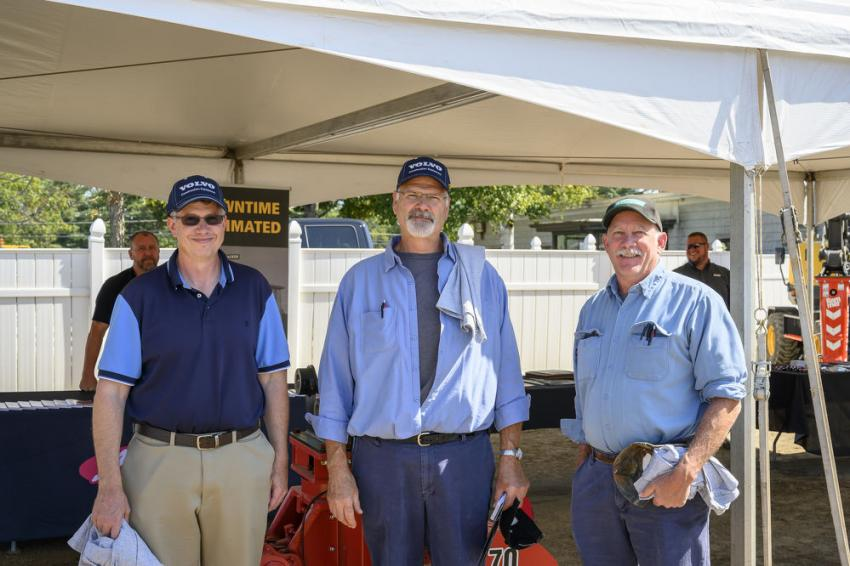 (L-R): Rob Robinson, Harry Loiselle and Robert Morris, all of the city of Manchester, check out the vendor information tents.