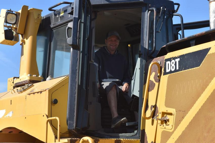 Sam Foster, vice president of Cedar Lane Excavations, Davidsonville, Md., was a kid in a candy shop sitting in the cab of this Caterpillar D8T.
