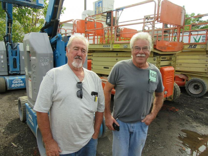 Terry Wenzel (L) of Hudson Truck and Oil joined Hubert Dietrich of North Coast Construction to look at the equipment at the auction.