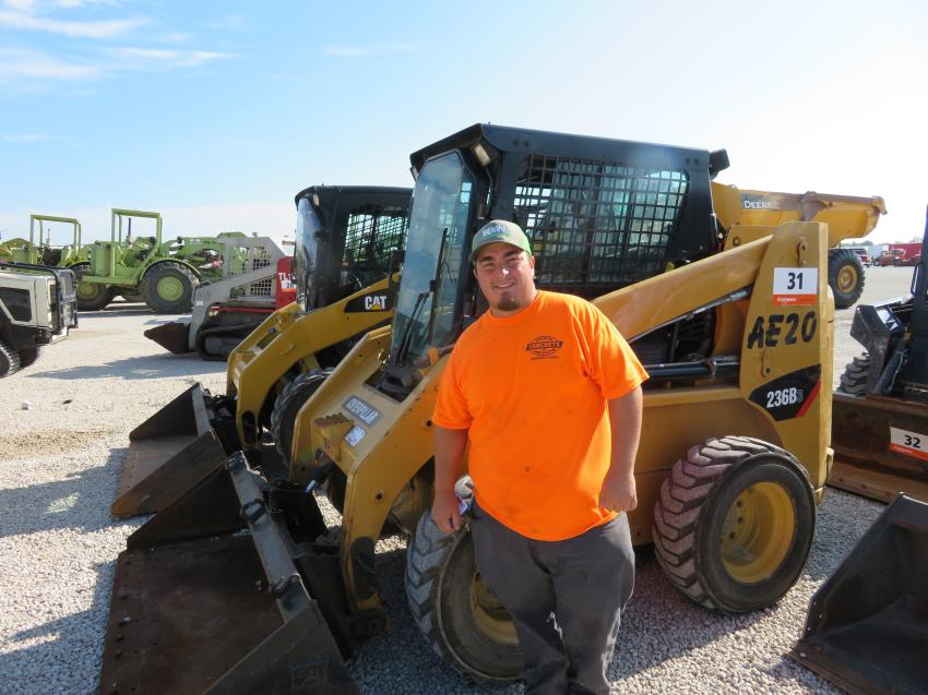Anthony Laudicina of Premier Concrete Construction Inc., Rockford, Ill., checks over this Cat 236B skid steer.