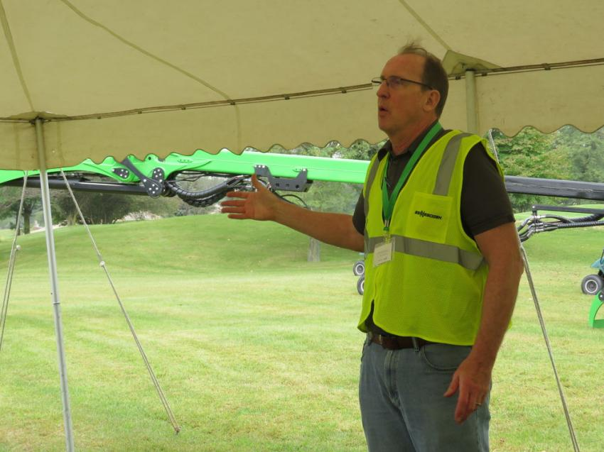 Bill McNamara, area manager of Howell Tractor & Equipment, welcomes everyone to the Sennebogen 718E tree cutting demonstration.