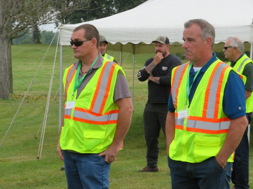 Scott McCormick (L) and Scott Reposh, both of Homer Tree Service, watch the Sennebogen 718E cut down trees with ease.