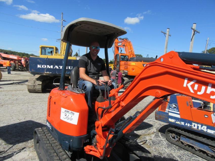 Joe Built Homes' Joe Corron, puts this Kubota U20 mini-excavator through its paces at the auction.
