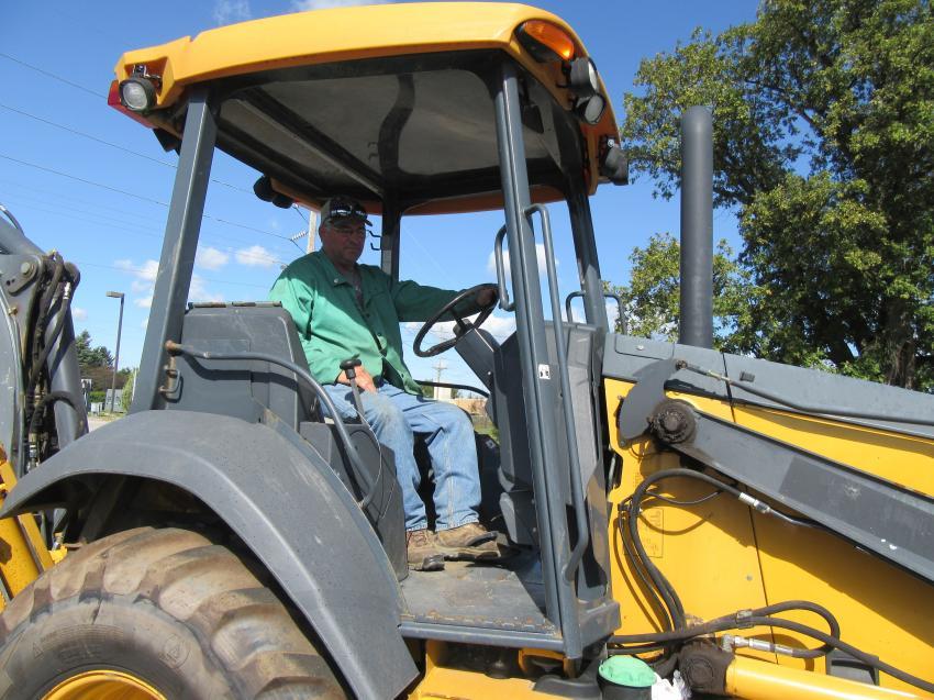 Brooks Winegardner of Winegardner Farms considers a bid on this John Deere 310K backhoe.