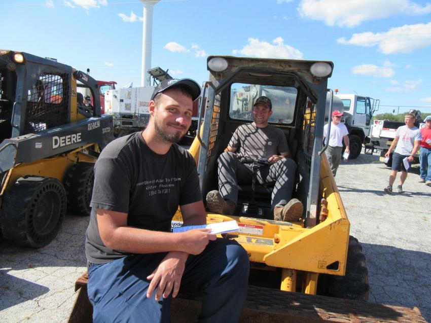 Don Taylor (L) of Taylor Equipment and Nick Burger of Burger Farms tried out this Mustang 2054 skid steer at the auction.