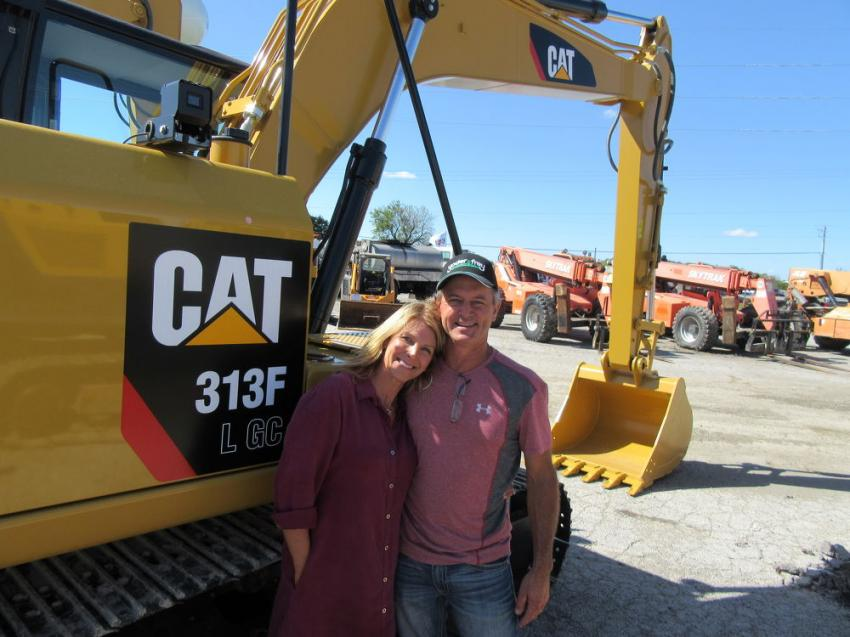 Amy and Charlie Heidrick of Heidrick Earth Moving came in from Danville, Ill., in hopes of taking home an excavator from the auction.