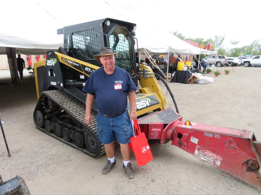 Logan Sammons of Doug & Steve's Construction looks over this ASV RT-75 with a LaBounty MSD7R shear.