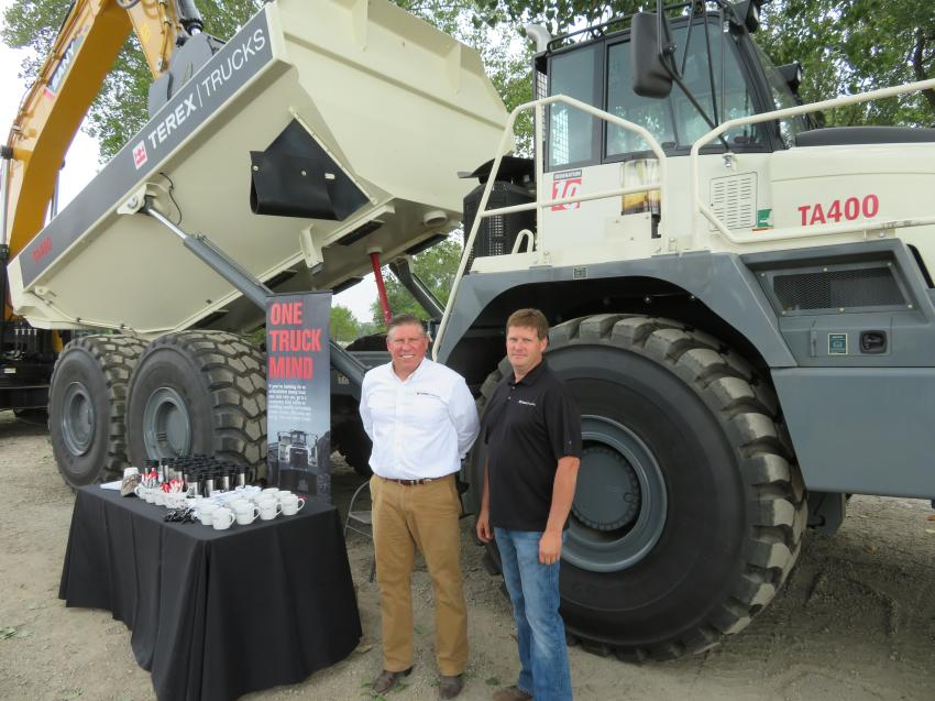 Representing Terex Trucks are Greg Gerbus (L) and Corey Leonard displaying the Terex TA400 articulated truck for the customers.