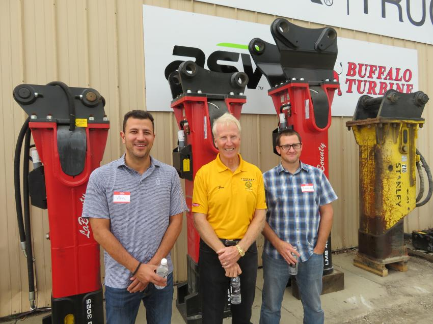 Joe Thoesen (C), president of Thoesen Tractor & Equipment, shows the LaBounty Hammer line up to Paul Todoroski (L) and Brandon Darger of John Burns Construction.