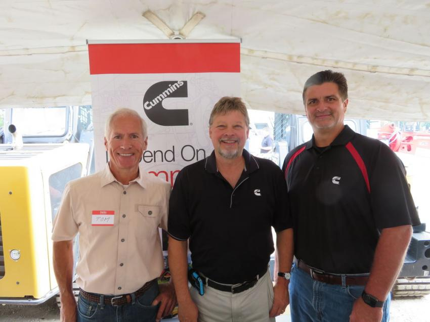 (L-R): Tom Cera of South Shore Metals stops by the Cummins display to see Tony Priano and Joe Stack, both of Cummins sales and services.