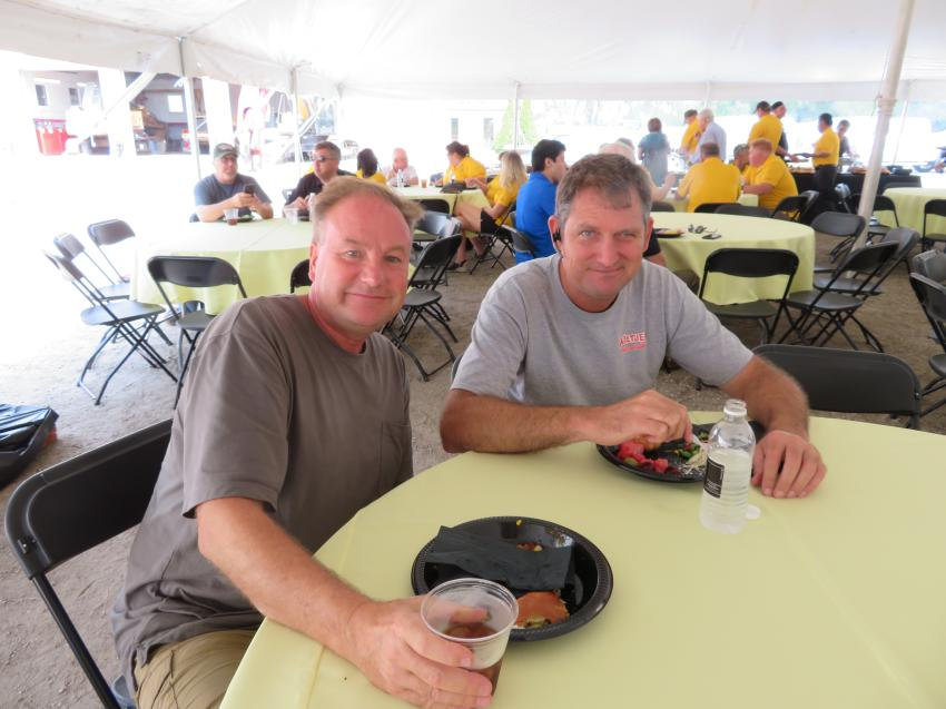 Joe Soucie (L) and Lee Wiltjer, owner of Wiltjer Excavating are enjoying the catered lunch at the 50th anniversary celebration.
