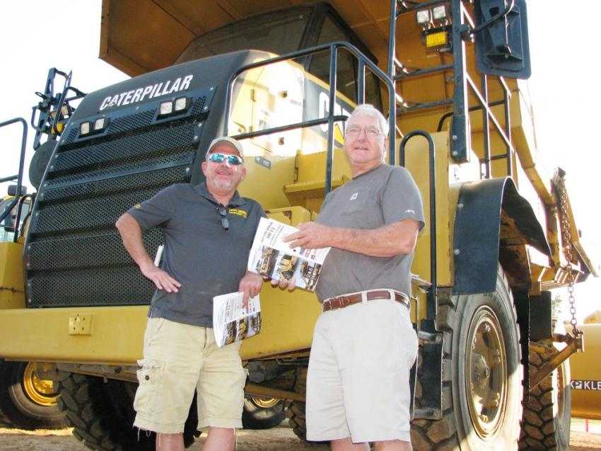 Talking about the Cat 770 off-road trucks are Scott Crowe (L) of Crowe Equipment, Jasonville, Ind., and Wally Sexton of Sexton Inc., Santa Claus, Ind.
