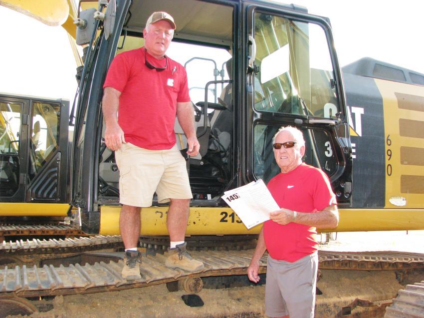 Wrapping up their inspection of a Cat 320EL excavator are Chuck Wigington (L) and his dad, Bob Wigington, of Wigington Contractors, Jasper, Ga.