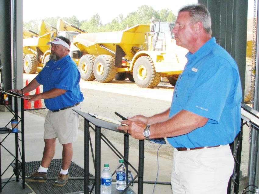 JM Wood staffers Wheeler Johnson (L) and Greg Avant scan the crowd for a final bid before the gavel drops on another off-road truck sale.