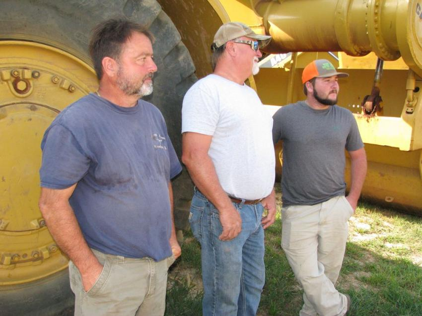 Watching and waiting for their machines of choice to go on the auction block (L-R) are Rick, Randy and Justin George of George Grading and Hauling, Franklin, Ga.